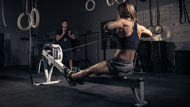Woman doing a workout on a rowing machine