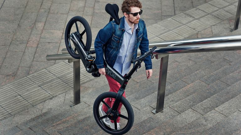 Hipster struggling to carry bike