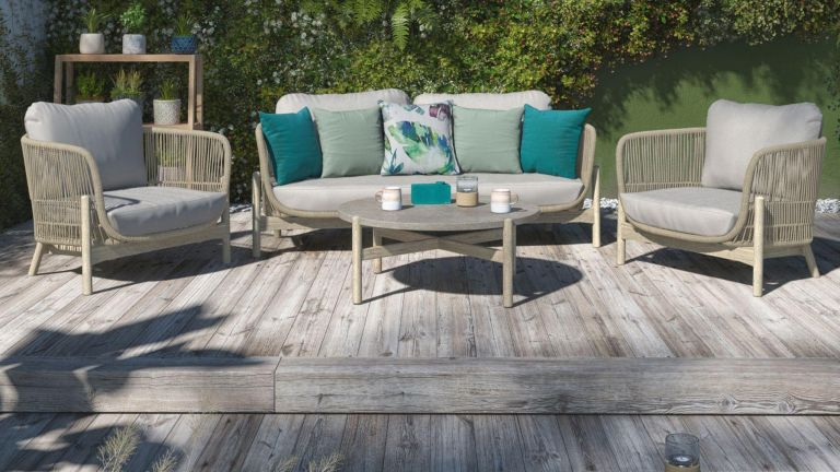 landscaping ideas: raised deck area with garden sofa set
