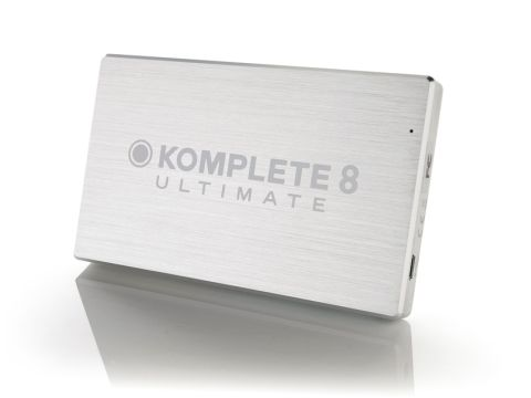 Komplete 8 Ultimate's files are installed from a shiny silver USB drive.
