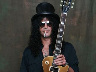 Slash shows off one of his new Gibson signature models