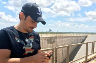 "Country music star Brad Paisley uses his phone to 'leak' his new song, ""American Flag on the Moon"" from NASA's historic Launch Pad 39B at the Kennedy Space Center in Florida."
