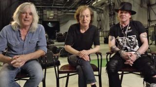 Cliff Williams, Angus Young and Axl Rose