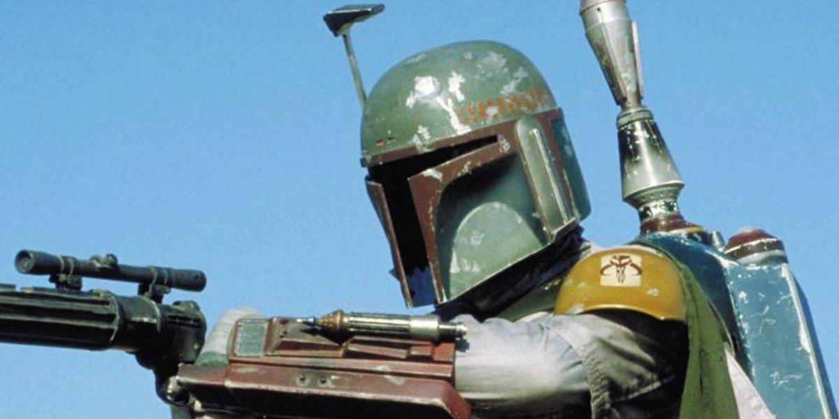 Boba Fett holding a blaster Star Wars