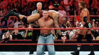 John Cena delivering an Attitude Adjustment to Randy Orton