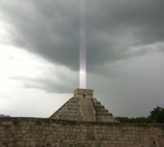 """El Castillo,"" a Mayan temple on the Yucatan Peninsula in Mexico, with a mysterious ""light beam"" emerging from the top. Credit: Hector Siliezar"