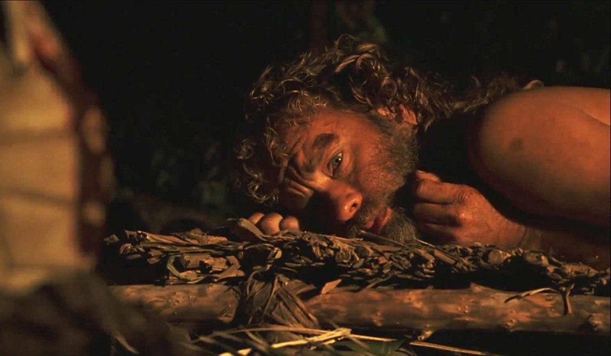 Cast Away Tom Hanks lies on the ground, looking at Wilson