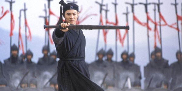 Hero Jet li stands in front of his army with a weapon in hand