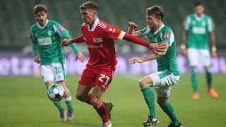 Union Berlin player Grischa Promel (centre)