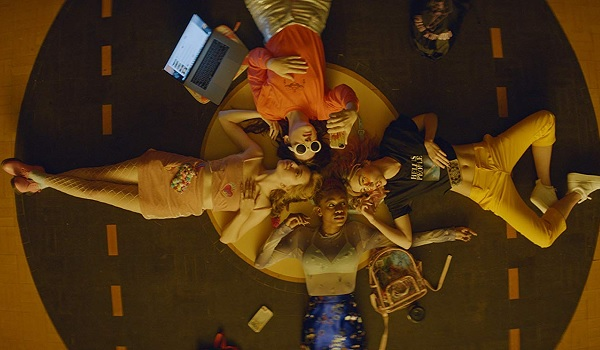 Assassination Nation the girls lay on the gym floor in a circle