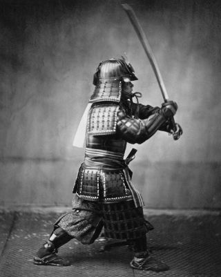 A Samurai in full armor with sword.