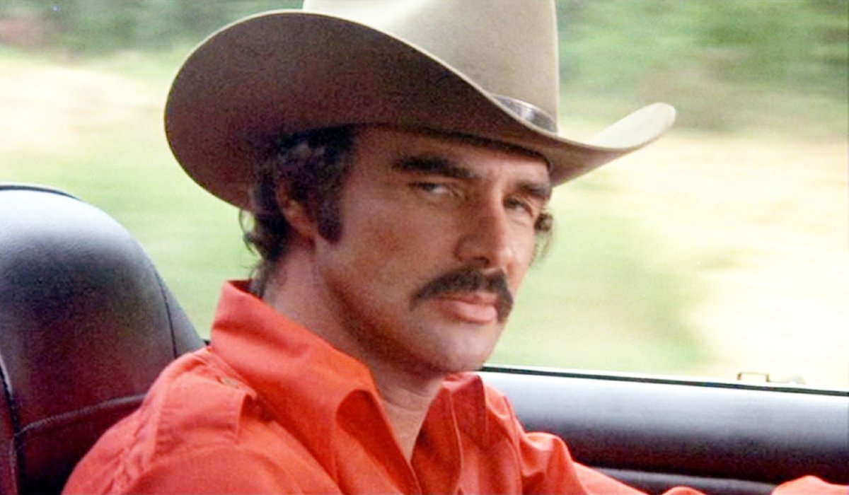 Smokey and The Bandit Burt Reynolds giving some side eye in the driver's seat