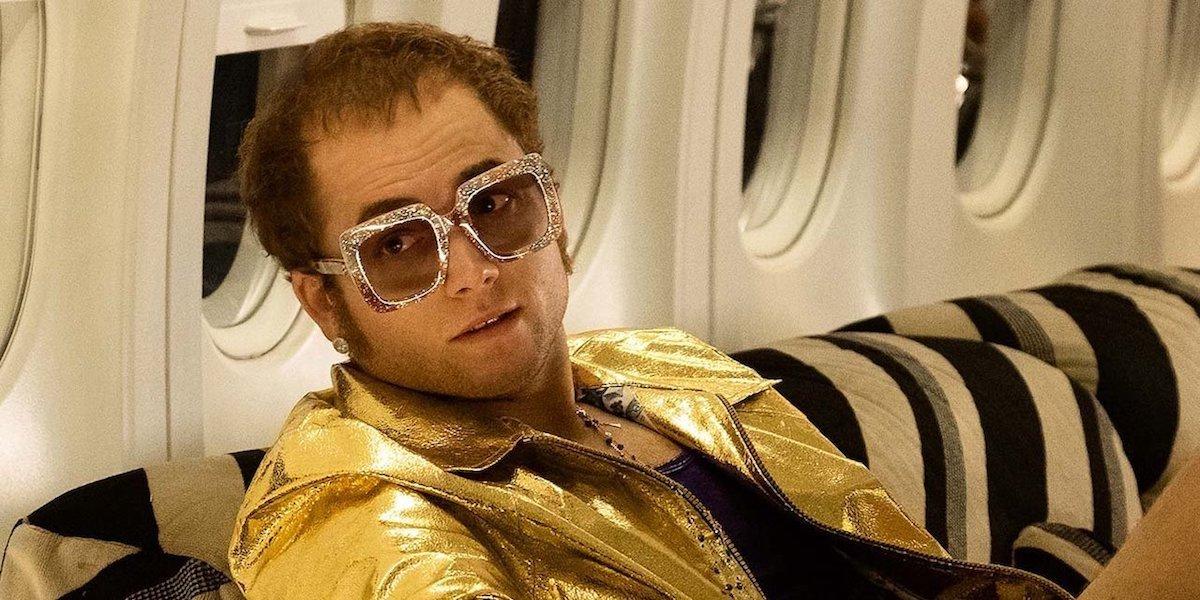 Elton John (Taron Egerton) sits on a plane in a scene from 'Rocketman'
