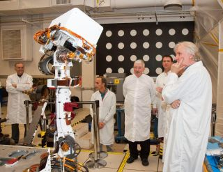Academy Award-winning director James Cameron (right) inspects engineering model of camera mast for NASA's Curiosity Mars rover. Cameron is a member of the camera team for the Red Planet mission