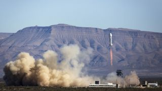 The reusable New Shepard space vehicle ascends through clear skies to an apogee of 339,138 feet (103,369 meters).