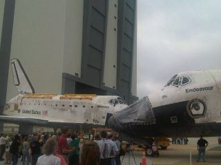 NASA's space shuttles Discovery and Endeavour meet nose to nose as they cross paths at Florida's Kennedy Space Center.