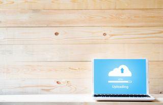 best cloud storage - a laptop with a cloud on it
