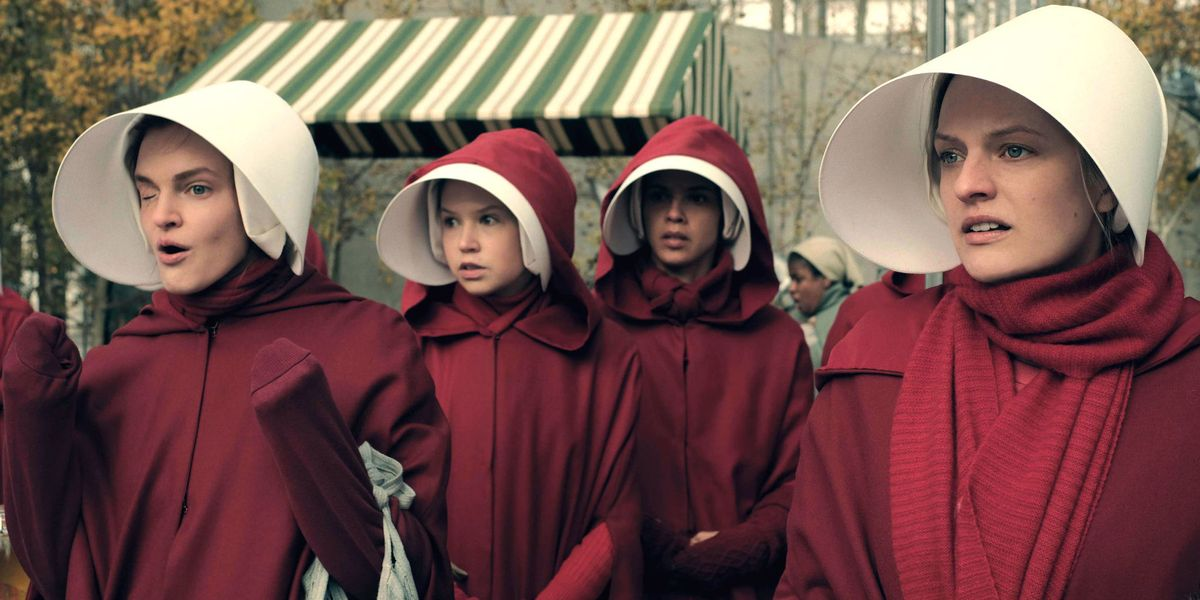 Some of the cast of The Handmaid's Tale in their iconic outfits.