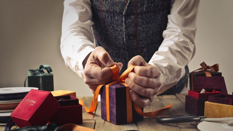 Man wrapping a Christmas present