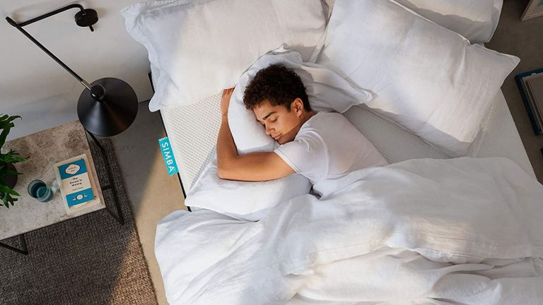Amazon spring sale: Simba mattress on bed with man sleeping