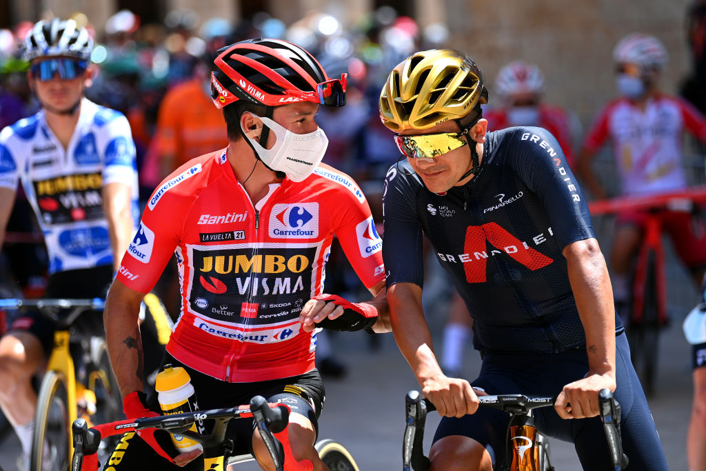 BURGOS SPAIN AUGUST 15 LR Primoz Roglic of Slovenia and Team Jumbo Visma red leader jersey and Richard Carapaz of Ecuador and Team INEOS Grenadiers winner of Olympic road race prepare for the race prior to the 76th Tour of Spain 2021 Stage 2 a 1667km stage from Caleruega Monasterio de Santo Domingo de Guzmn to Burgos Gamonal lavuelta LaVuelta21 CapitalMundialdelCiclismo on August 15 2021 in Burgos Spain Photo by Stuart FranklinGetty Images