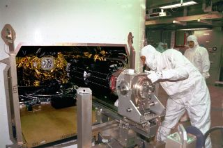 Engineers install one of the three radioisotope thermoelectric generators (RTGs) on NASA's Cassini spacecraft, which orbited Saturn from 2004 to 2017.