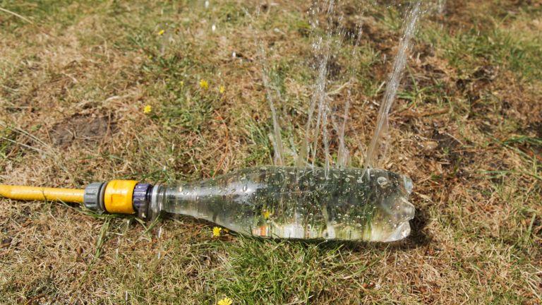 A soda water bottle diy sprinkler system