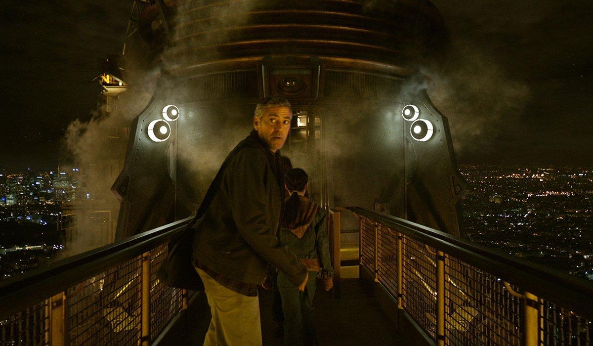 Tomorrowland George Clooney looks back as the kids walk towards the capsule