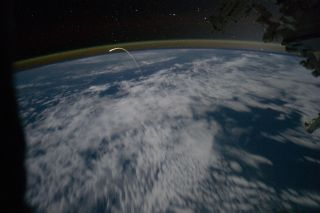 Atlantis' Re-entry Seen from the International Space Station