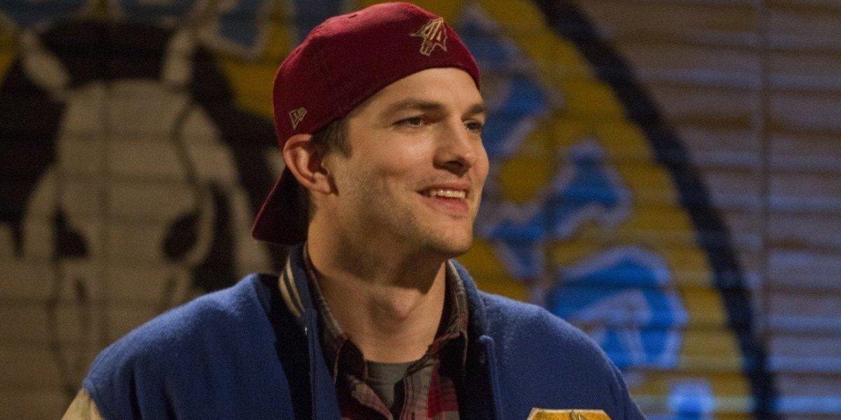 Colt Bennett (Ashton Kutcher) smiles on The Ranch