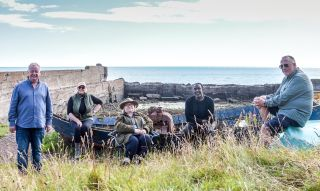 Les, Fern, Rosemary, Linford and Ian relax on Auchmithie beach.