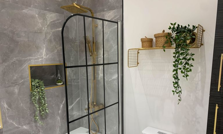 White modern bathroom with black accent and gilded features