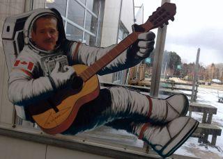 Hadfield Avatar Playing Guitar