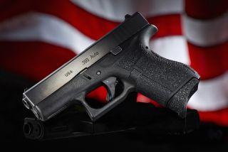handgun with American flag background