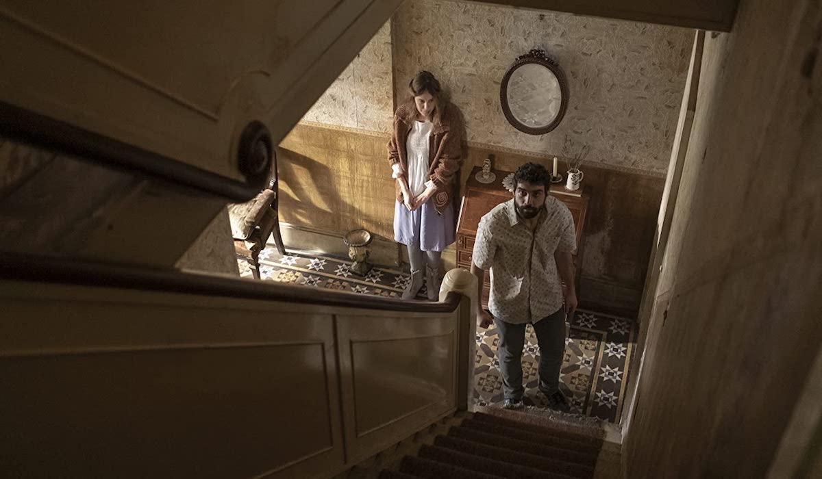 Alec Secareanu and Carla Juri in Amulet