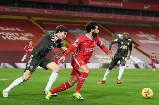 Mohamed Salah challenged by Victor Lindelöf