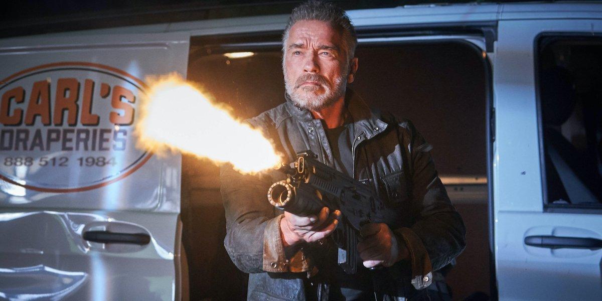T-800/Carl (Arnold Schwarzenegger) blasts a weapon in Terminator: Dark Fate (2019)