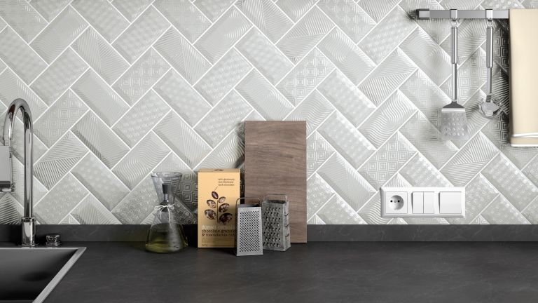 Textured grey tiles as a kitchen splashback