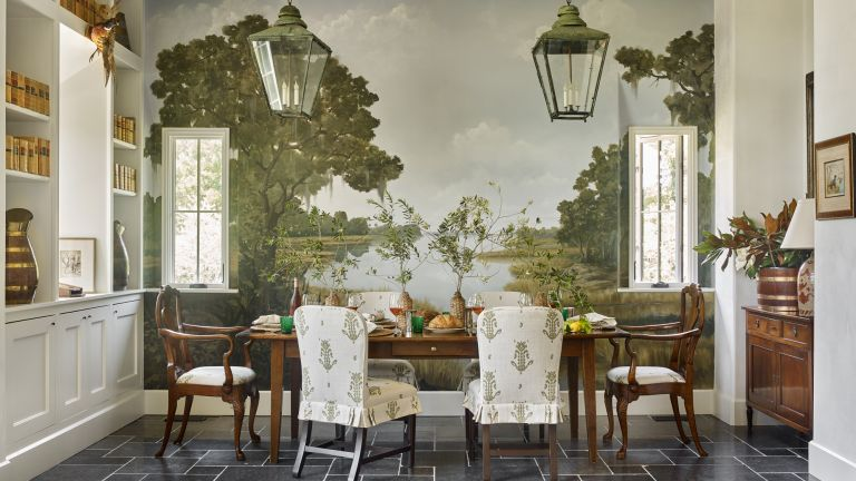 A dining room with pastoral mural, mahogany dining suite and antique lanterns