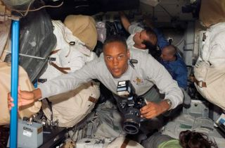 Shuttle Astronauts Haul Cargo, Prepare for Spacewalk