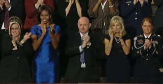 Former NASA astronaut Mark Kelly applauds President Barack Obama after the 2012 State of the Union address on Jan. 24, 2012.
