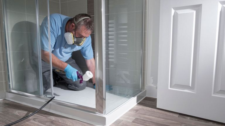man fixing shower with diy skills by plastic surgeon