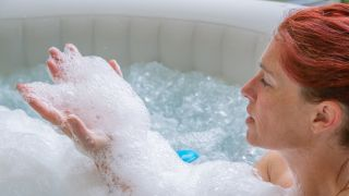 How to clean and maintain an inflatable hot tub — woman in an inflatable Hot Tub