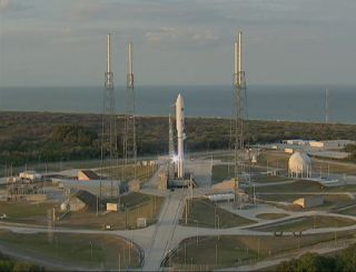 A United Launch Alliance rocket carrying the U.S. Navy's MUOS-1 satellite stands poised for launch in this view from a ULA webcast on Feb. 16, 2012.