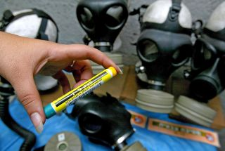 A female Israeli soldier holds a dose of Atropine, used as an antidote in case of a nerve gas attack, at an Israeli army gas mask distribution center in a shopping mall December 30, 2002 in Jerusalem, Israel.