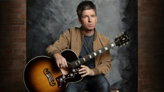 Noel Gallagher with the Gibson signature J-150 acoustic guitar