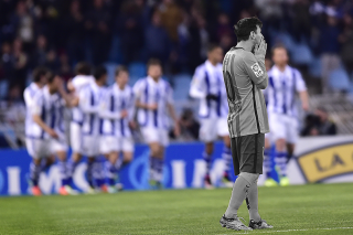 Lionel Messi reacts in Barcelona's defeat at Real Sociedad
