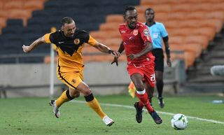 Mohamed Amadou Djibo of Horoya AC challenged by Samir Nurkovic of Kaizer Chiefs