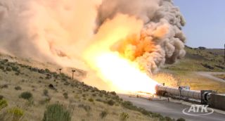Side view of ATK's Sept. 8, 2011 test firing of the DM3 solid rocket motor, a five-segment booster.