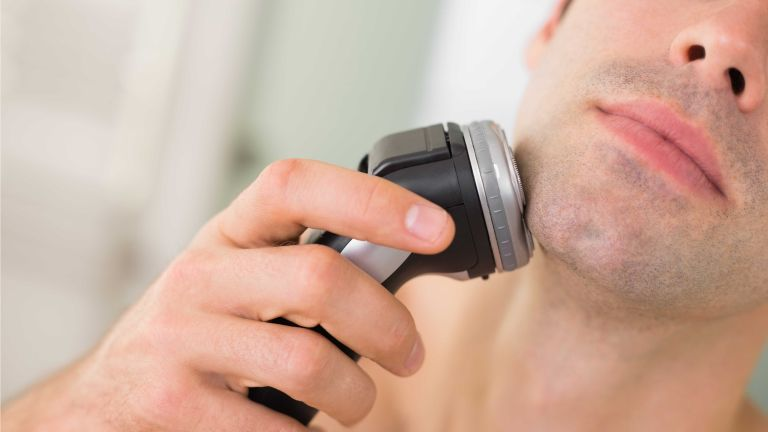 Best electric shaver: Shutterstock image of man shaving face